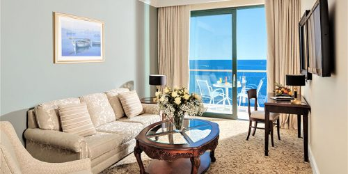 Royal-Princess_-Deluxe-King-Suite-Sea-View_living-room-1